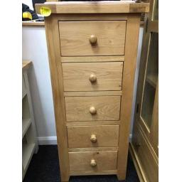 GOOD QUALITY REAL OAK TALL NARROW CHEST.