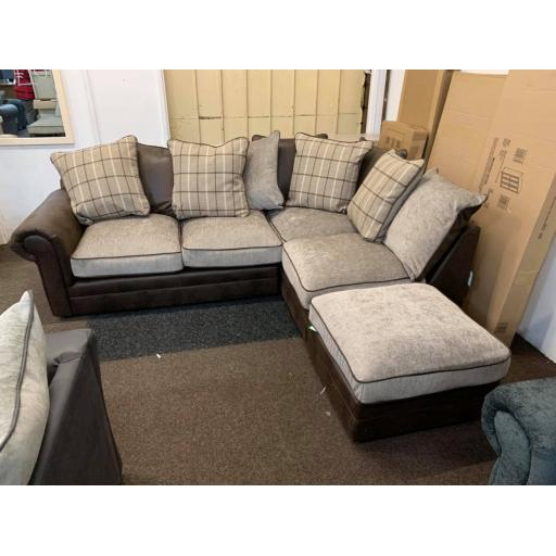Brown Corner sofa with tartan patterned scatter cushions with footstool