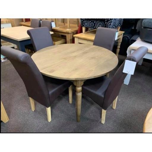 Oak round table with 4 chairs ( either black or brown )