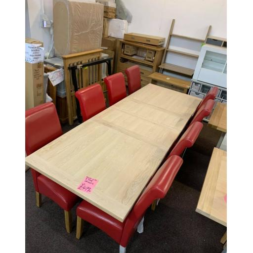 GREY AND OAK DINNING TABLE WITH 8 RED CHAIRS