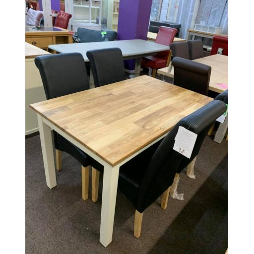 CREAM AND OAK TABLE WITH 4 BLACK CHAIRS